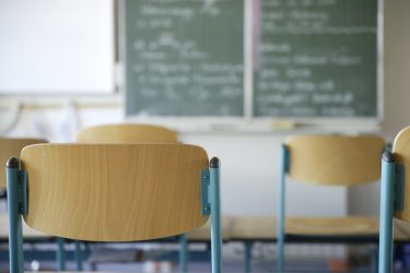 Germany, Bavaria, Chairs and blackboard in classroom